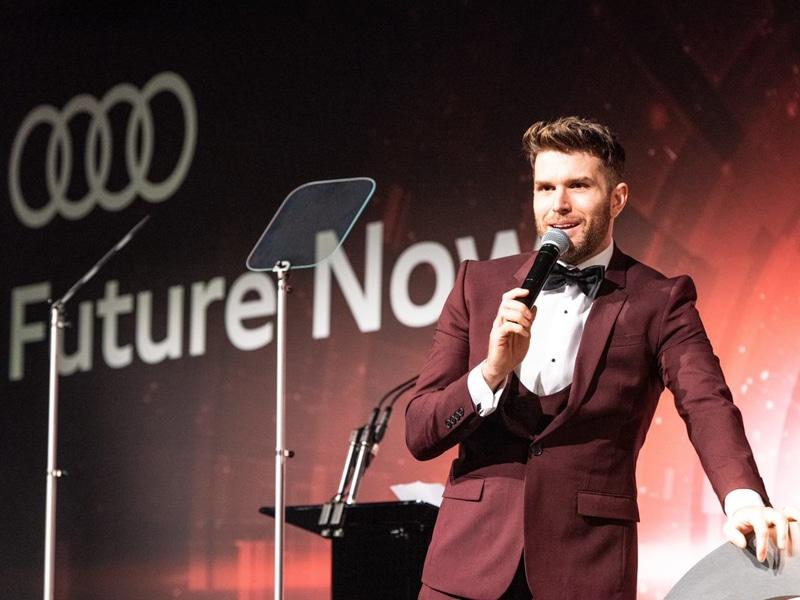 Joel Dommett presenting at Audi graduation